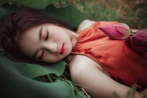 Medium woman lying on green plant 1322137  1