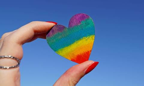 Medium photo of person holding multicolored heart decor 1173576  1